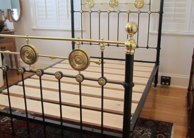 Satin Black and Brass bed with brass feature medallions, low four poster